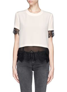 Combining a sheer black lace underlay with a white silk top, this piece from Sandro will look cool with a pair of skinny pants and is perfect for smart or casual off-duty days.