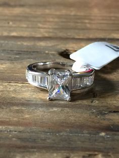 A Perfect 2CT Emerald Cut Russian Lab Diamond Ring with Channel Set Baguettes