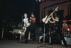 British punk group The Clash performing on stage 1980 Standing left to right Joe Strummer Mick Jones and Paul Simonon Topper Headon is on drums