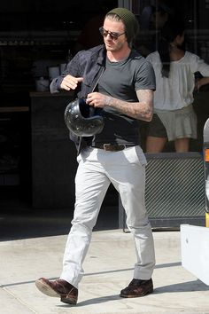 David Beckham leaves lunch on his vintage motorbike in Los Angeles