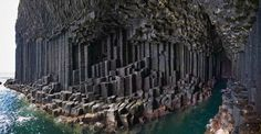 Fingal's Cave on Staffa, Scotland. Like the Giant's Causeway, this cave was formed by lava cooling and fracturing over millions of years. The jagged formations outside are entirely nature's doing.