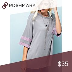 "Oversized Tee COLOR BLOCK GRAY & LAVENDER OVERSIZED TOP WITH PANELED SLEEVES 95%RAYON 5%SPANDEX. MEASUREMENTS LYING FLAT BUST S21"" M22"" L23"" LENGTH S26"" M27"" L28"" Angelique's Atelier Tops Tees - Short Sleeve"