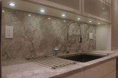 LED Puck Lights  Under this kitchen cabinet, six energy-saving LED recessed puck lights illuminate the countertop work area while highlighting the quartzite backsplash. LED puck lights are a great replacement for xenon puck lighting fixtures, which give off heat
