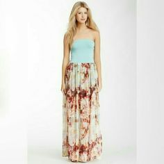 """Beautiful Twist Back Maxi Dress Elasticized strapless maxi with cutout twist back detail. Long flowy printed skirt bottom. Approximately 55"""" length. New without tags NWOT Remain Dresses Maxi"""