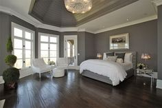 Love this bedroom: dark wood floors, floor to ceiling windows, gray paint