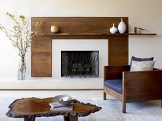This fireplace screen captures a natural, modern aesthetic and mimics the look of branches. Design by Amy Lau Design; Photography by Hulya Kolabas   contemporary space   sculptures on mantel   wooden mantel on contemporary fireplace   modern rustic living room