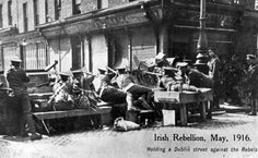 April British troops at a makeshift barricade, at a key point in the city, The Irish rebellion began on Easter Monday April 1916 when the Irish rebels attempted to gain control of public buildings in Dublin. (Photo by Popperfoto/Getty Images) Dublin Street, Dublin City, Ireland 1916, Dublin Ireland, Old Pictures, Old Photos, Irish Independence, Easter Rising, Irish Eyes