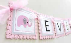 Adorable Pink Elephant banner to adorn your party, whether it's a birthday or a baby shower. Take a look at this cute pink elephant with its gray striped ear. A playful gray polkadot pattern is seen from one end to the other end of the banner. Each square edge is done beautifully with scallop mot...