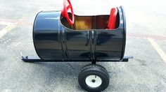 55 Gallon Metal Barrel Train Car / Wagon Black & Red. We pull it with our golf cart.