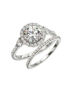Love this vintage look with two pear shape diamonds on the side from Mark Patterson.