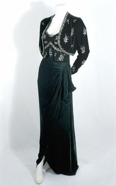 Evening Ensemble: ca. 1940, velvet, silk-lined bodice, draped skirt with deep slit, bolero jacket, jacket and bodice embellished with rhinestones and clear crystal beads.