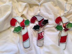 Stained Glass Candy Cane Christmas Ornaments by DsGlassDesigns, $25.00 Stained Glass Ornaments, Stained Glass Christmas, Stained Glass Suncatchers, Stained Glass Flowers, Faux Stained Glass, Stained Glass Designs, Stained Glass Projects, Stained Glass Patterns, Glass Christmas Decorations