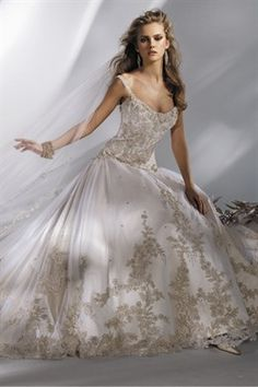 Eve of Milady - This dress is very similar to my wedding dress, also by Eve of Milady. But my dress was all ivory. This designer's dresses are beautiful.