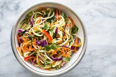 Asian Zucchini Noodle Salad ~ Zucchini noodles with cabbage, carrots, red bell pepper, green onions, tossed with a sesame rice vinegar dressing. Light, fresh, and easy! ~ SimplyRecipes.com