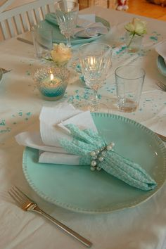 Turquoise themed tablescape ~ Thread some craft store pearls on a wire to make the napkin ring.