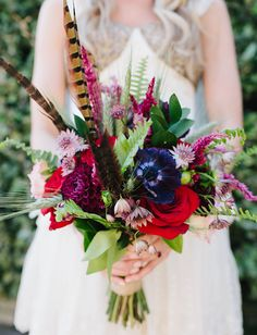 Bold hued bouquet with feather details