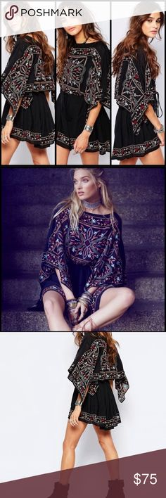 Free People embroidered Frida Dress Free People Embroidered Frida Dress in Black size XS worn once. Perfect like new condition. No flaws. Pet and smoke free home. Free People Dresses Mini