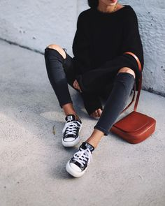 "justthedesign: "" Andy Csinger wears black and white low-top converse with rolled distressed jeans, and a cosy black knitted sweater. Sweater: H&M, Jeans: Topshop, Shoes: Converse. """