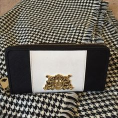 """Beautiful black/white w/ gold Juicy Couture wallet Juicy couture wallet. Gold embellishments and zipper. Perfect condition. Inside is dark dark blue with crowns. Super spacious multiple compartments inside with change pocket. Dimensions: 4""""x8"""" Juicy Couture Bags Wallets"""