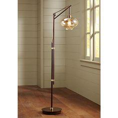 This industrial style downbridge floor lamp features cognac glass surrounding a Nostalgic Edison bulb.