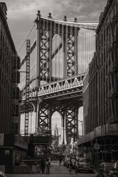 Empire State Building through the eye of the Manhattan Bridge via elizak1.tumblr