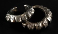 Pakistan | Handmade vintage hollow bracelets from Baluchistan | Silver | Some times these types of bracelets contained small bells inside their hollow casing, as a way to warn visitors of the house to go when women approached the room