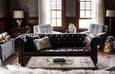 Dark leather sofa and salvaged wood coffee table