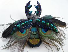 Stag beetle ornament faux taxidermy feather work by Skullbag