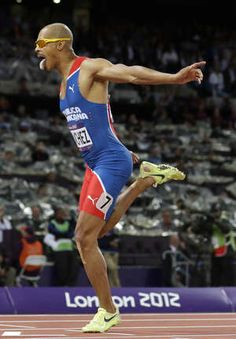 PHOTO: Dominican Republic's Felix Sanchez reacts as he crosses the finish line to win gold in the men's 400-meter hurdles final during the athletics in the Olympic Stadium at the 2012 Summer Olympics, London, Monday, Aug. 6, 2012. (AP Photo/David J. Phillip )
