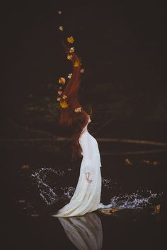 The water spiraled upwards until falling back into the pond, revealing only the Naiad leader floating upon the water.
