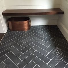 Amy Vermillion's Home- Hand cut herringbone slate tile floor in Mudroom. Ship lap walls, walnut bench.