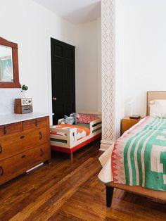 Narrow-Leg Nailhead Upholstered Bed Frame from West Elm. Via @Design*Sponge. Photo by Alice Gao