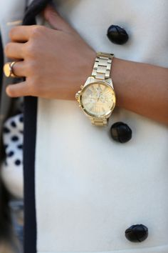 Oversized gold watch.