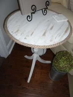 This was the table with the white tassel fringe. Now rope with gel satin.