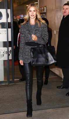 Rosie Huntington-Whiteley leaves the airport in a gray belted sweater, leather skinny pants, black suede boots, and a black leather satchel