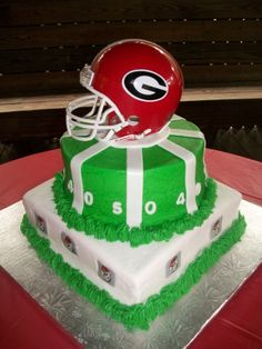Georgia Bulldog Grooms Cake, but instead of white at the bottom do red with black arches. (: