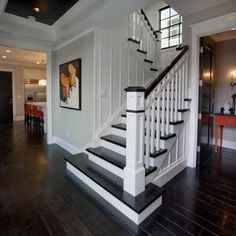 Entry Hall, Stairs and Powder Bath - traditional - staircase - orange county - Details a Design Firm Home, Staircase Railings, Interior Design Hallway, New Homes, Traditional Staircase, Stair Railing Design, Black Wood Floors, Entry Hall, Black And White Stairs