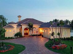 Plan W24021BG: Florida, Photo Gallery, Luxury, Mediterranean, Premium Collection, Corner Lot House Plans & Home Designs
