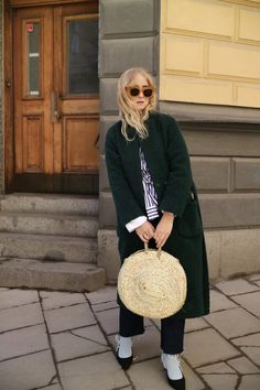straw bag | winter coat | striped shirt | amber sunglasses
