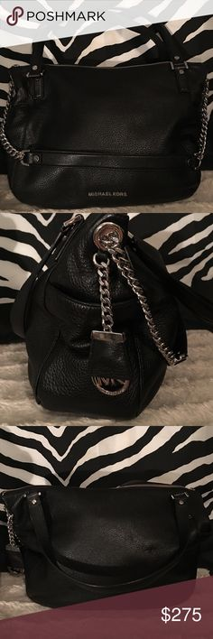 Authentic Michael Kors shoulder tote Authentic black soft pebbled leather Michael Kors shoulder tote with two side pockets  and Mk logo silver medallion hanging from one side. zipper closure for added safety and longer chain shoulder strap. This bag is in mint condition inside and out no rips tears stains or holes. Trade value is $350 Michael Kors Bags Shoulder Bags