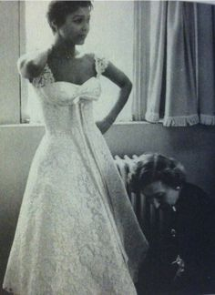 "Dorothy Dandridge in an embroidered lace dress, being fitted for a gown. This picture is apart of the ""Fitting Session of The American Actress Dorothy Dandridge"", collection by Willy Rizzo."