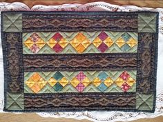 Made from left over scraps for the first Holy Name of Mary  raffle quilt I made.
