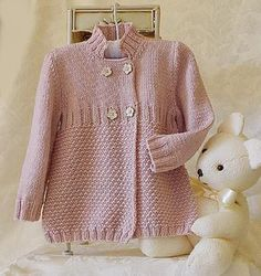 A gorgeous pink yarn suits this Little girls three quarter length double breasted coat/jacket perfectly! Use Sublime Extra Fine Merino DK in Powderpuff - Don't worry, we'll pin it!