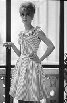 Catherine Deneuve in striped dress - Vertically striped dress, with some embellishment at bodice