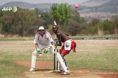 SOUTH AFRICA, Alberton : A Maasai Warriors cricket player gets ready to  play a shot during a cricket match between Maasai Warriors and Glenvista  Cricket Club invitational side at the Klipriviersberg Recreation Centre  in Alberton on September 13, 2015. The Maasai Cricket Warriors, an  ethnic group from Kenya, are visiting South Africa playing cricket to  raise awareness for the fight against rhino poaching. In 2014, South  Africa lost a record of 1,215 rhinos to illegal poaching. AFP…
