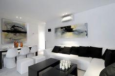 El minimalismo no utiliza telas estampadas, decántate por los colores puros para los sofás, cojines y ropa de cama.