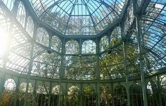 Crystal Palace in Madrid's Buen Retiro Park is a beautiful  glass and metal structure, built in 1887  to exhibit flora and fauna from the Philippines