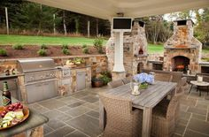 comfortable corner outdoor patio with custom fireplace. Black Bedroom Furniture Sets. Home Design Ideas