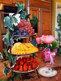 Cocktail hour - tea party snacks: fruit and vegetable trays with dips