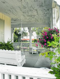 Shabby front porch. Mostly love the swing.
